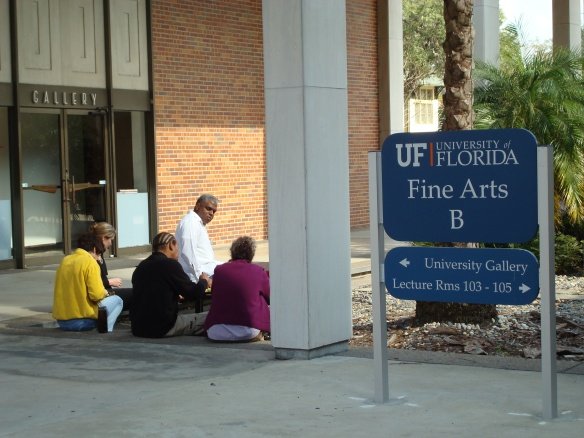 Participating artists enjoying lunch outside the gallery.