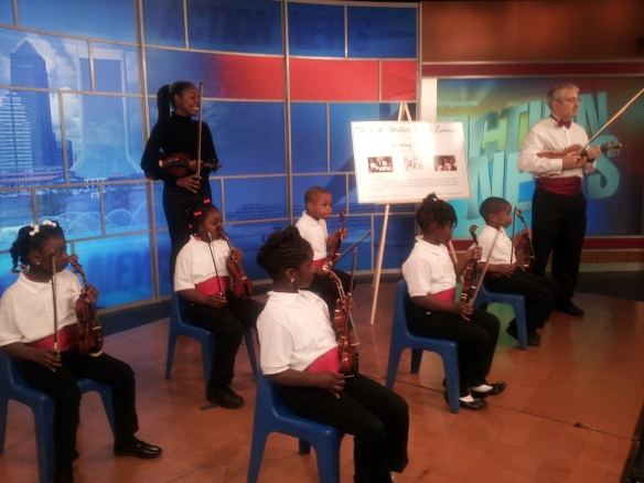 On the set at Fox 30 Action News during the morning show. This was the first public television performance for the students. Photo used by permission of Richard Cuff.