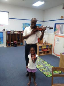 Richard Cuff with Ashlyn after she is fitted for her violin. Image used with permission of Richard Cuff.