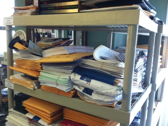Our file room is filled with stacks of support materials that were mailed in as part of applications.