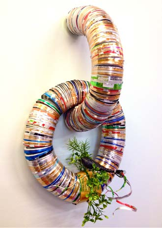 """""""Quetzal sittin'..."""" by Sarah Crooks Flaire, recycled aluminum , vhs tape, and plastic greenery 22""""x13""""x4"""""""